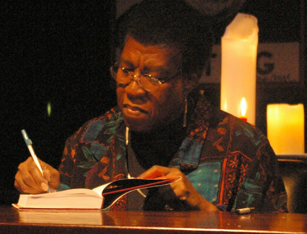 Octavia Butler signing a copy of The Fledgling